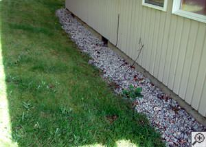 A yard that has been graded to slope towards the foundation in Elma